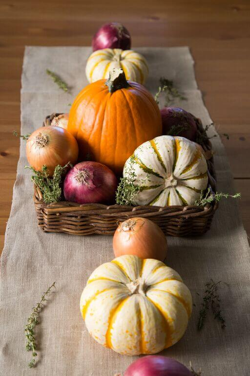 Thanksgiving centerpiece with onions and pumpkins