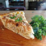 Slice of onion pie with parsley