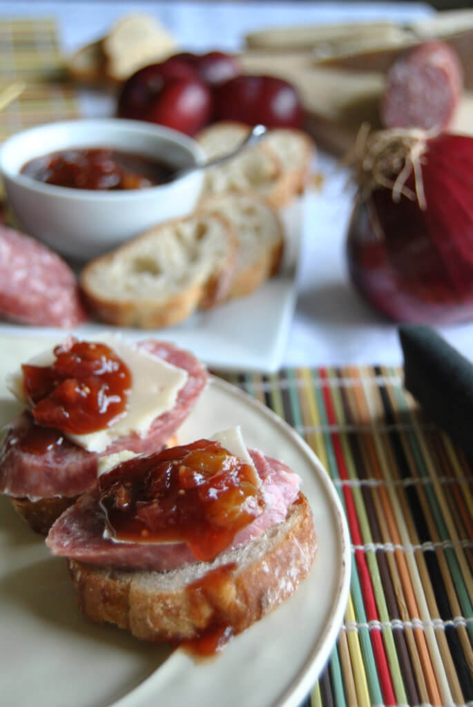 Asian Plum Onion Chutney on bread with cheese and sausage