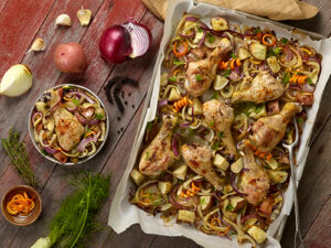 Chicken Drumsticks and vegetables on a sheet pan