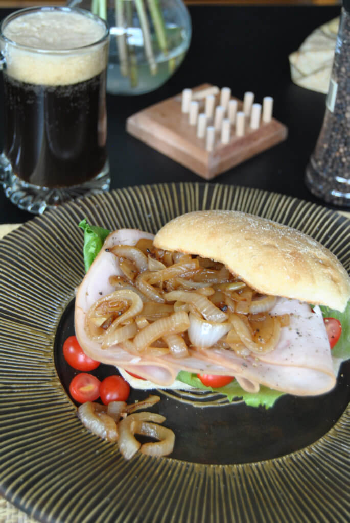 Turkey Sandwich with Caramelized onions on black background