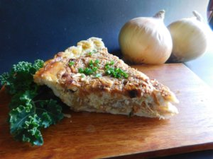 Southern Savory Onion Pie on cutting board