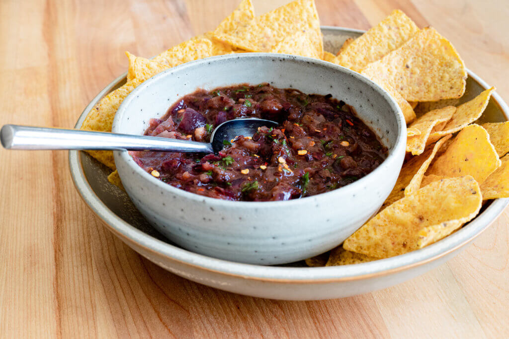 Charred Red Onion Salsa in bowl with chips