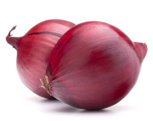 Two red onions with skins