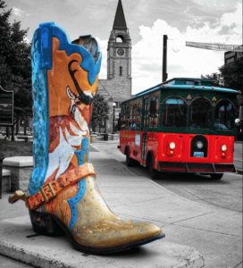 Colorful boot near trolly car in Wyoming