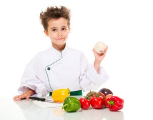 young chef holding onion