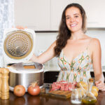 Woman in kitchen with Instant Pot