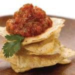 Charred Tomato n Onion Salsa on stack of tortilla chips